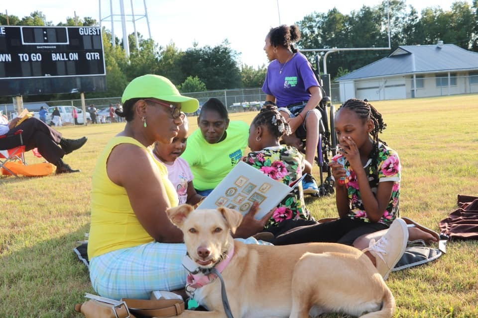 Families reading at ACS Reading Under the Stars event